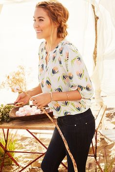 The slight volume of a peasant top perfectly balances the slim fit of your favorite skinny jeans. Dark denim? Go for a floral watercolor print in light colors. Get this LC Lauren Conrad look only at Kohl's.