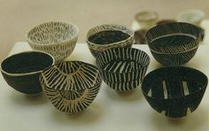 bowls. Not only are the designs stunning but it's really difficult to make bowls this thin in ceramics without breakage.