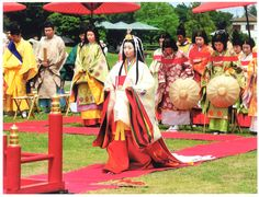 Men and women dressed in heian robes for an event.