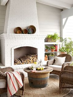 Enclosed Area The combination of warm weather and a fireplace (painted China White by Benjamin Moore) makes the outdoor living area of this California home a year-round hangout. Read more: Fireplace Designs - Fireplace Photos - Country Living Outdoor Fireplace, Decor, Home, White Brick, White Brick Fireplace, Fireplace Design, Outdoor Living Room, Brick Fireplace, Fireplace