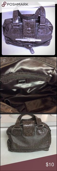 Guess brand Purse Bought on Posh, very cute Purse, will go with anything. Mint condition I'm only selling to downsize Guess Bags