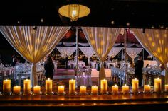 Candles lined the room to give this wedding a romantic feel. #wedding #candles #pillarcandles