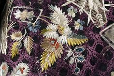 Detail embroidery, court coat, France, c. 1775. Purple silk, lavishly embroidered with naturalistic flowers in coloured silk.