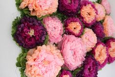 Create a stunning Spring backdrop at your next event with tissue paper flowers!   Just Artifacts