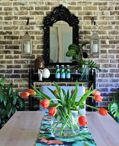 Outdoor dining room with black buffet and mirror