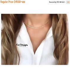 A personal favorite from my Etsy shop https://www.etsy.com/listing/246400118/on-sale-gold-choker-bar-necklace-gold