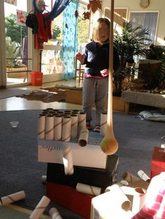 Pendulum Ideas in the classroom.  We strung up a tennis ball tucked into a stocking from the rafters.Then we provided the children with an assortment of different sized boxes, cardboard cylinders and small yogurt containers.