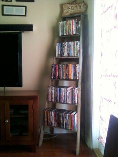 I made this dvd stand from an old wooden ladder! LOVE it!!