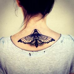 Moth tattoo.