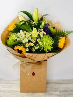 Delightful Daisy Lily and Sunflower Bouquet: Booker Flowers and Gifts