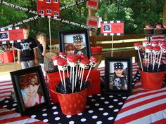 Pirate Party Table with Marshmallow Mateys, Cupcakes, and Photos of Birthday Pirates