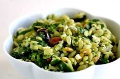 Classic spinach and orzo salad with orzo pasta, fresh spinach, feta cheese, pine nuts, Greek olives, and red onion.