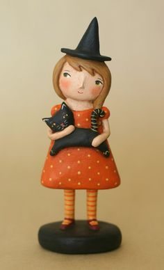 All dressed in her best orange dress and cute striped leggings, this little witch and her kitty are ready for a Spooky Night! Shes 6 1/8 to the