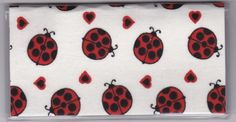 """Big Red Ladybugs and Hearts on White Checkbook Cover by Tickled Pink Boutique. $5.00. The sturdy clear VINYL COVER encases a fabric bonded design. Measuring 6 1/4"""" x 3 1/4"""",  the cover fits all standard bank checkbooks and banking registers.  All checkbook covers come with a register flap and a duplicate check flap  just like the bank, only flashier.  These checkbook covers are a great alternative to the expensive covers offered by banks and online check companies. Checkbook Cover, Online Checks, Vinyl Cover, Ladybugs, Banks, Women Accessories, Alternative, Hearts"""
