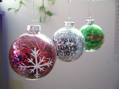 Clear glass (or plastic) ornaments + dollar store shiny tinsel = so cute!