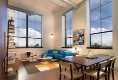 Luxury Living at Parkway Lofts! Beautiful living room with 13 ft windows!