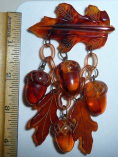 A great vintage Bakelite autumn leaf and acorn dangle brooch.