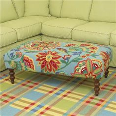Upscale on old coffee table to a rug-covered ottoman - because you know you'll put your feet their anyway!