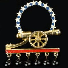 Silson WW2 US Patriotic Red White and Blue Golden Cannon with Halo of Stars, Stripe and Pendant Cannonballs Pin