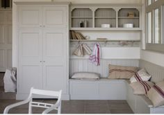 Plain English Boot Room - like wrap around seat and large store cupboard.