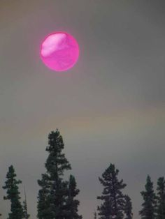 Sun takes on a surreal appearance through the smoke Wednesday evening around 8:45 p.m. as see from Dawson Road in North Pole. Photo by Reginald Swedberg.