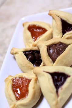 Hamantaschen  Lauran Kaplan recipe.   Ingredients:   1/2 cup soft unsalted butter   2/3 cup sugar   1 teaspoon vanilla extract   2 eggs   2 1/4 cups flour   2 teaspoons baking powder   pinch of salt  cool, cut in rounds, fill, fold, pinch and bake. So good.