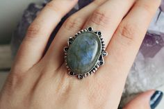 "Beautiful Labradorite 925 Silver Overlay ring from our ""Free Spirit"" rangeThis ring is a size M/NLore of the Inuit peoples claim Labradorite fell from the frozen fire of the Aurora Borealis, an ordinary stone that transforms to the extraordinary, shimmering in a mystical light that separates the waking world from unseen realms. It is, in every sense, a Stone of Magic, a crystal of shamans, diviners, healers, and all who travel and embrace the universe seeking knowled..."