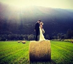 Country/ Farm wedding picture idea  megan perry... we need to find you and scott a bail of hay.  this is gorgeous.