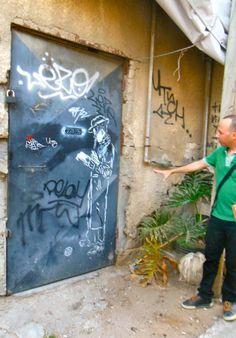 Guy parses graffiti with Orthodox Jew. http://www.streetwisehebrew.com Photo by Roman Mysteries author Caroline Lawrence. Friday 20 June 2014
