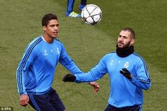 France internationals Raphael Varane and Karim Benzema keep their eye on the ball during the session