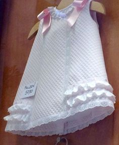 White sleeveless dress, trimmed with white lace and pink bows on shoulders, open… Little Dresses, Little Girl Dresses, Sewing For Kids, Baby Sewing, Fashion Kids, Baby Dress Design, Girl Dress Patterns, Kids Frocks, Toddler Dress