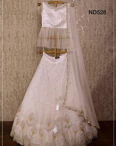 Trendy White Colored Designer Lehenga Choli with Matching Color unstiched blouse. It contained the Embroidered work with inner. The Lehenga can be customized up to bust size Lehenga Length Waist size and Dupatta size Mtr. Lehnga Dress, Lehenga Blouse, Lehenga Choli, Anarkali, Sarees, Lehenga Skirt, Peplum Blouse, Churidar, Patiala