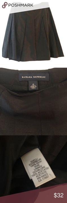 Banana Republic Black Silk Skirt Banana Republic Black Silk Skirt.  Size 0.  100% Silk.  Pleated style is very flattering.  Can be dressed up or down. Banana Republic Skirts