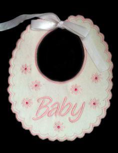 Un babero muy original e ideales para regalos de bebes recién nacidos. También apropiado para casos formales como bautizos, bodas etc. El material ...