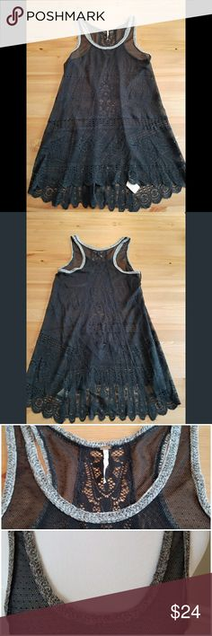 "Gorgeous Free People Sheer Lace Tunic Tank SZ S This is the most beautifully detailed black lace sheer tunic tank from Free People. Scoop neckline with signature FP knit trim in shades of brown and black, racer back style with intricate lace detailing up center of back. Hi low style with longer front length. Exceptional condition. Size small. 29"" long in front and 32"" long in back. Stretch nylon material. Free People Tops Tank Tops"