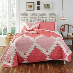 Refresh your master suite or guest room with this cotton quilt set, showcasing an oversized geometric pattern in coral and pink.   P...