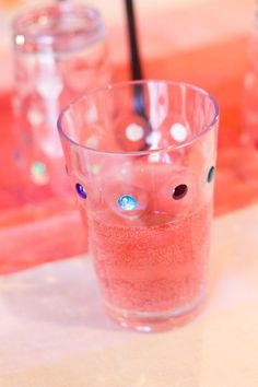 Add jewel stickers to plastic cups to make them look royal for a princess birthday party.