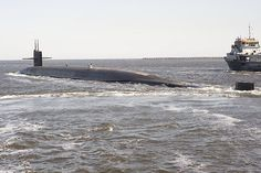 KINGS BAY, Ga. (March 15, 2013) The Ohio-class ballistic missile submarine USS Tennessee (SSBN 734) pulls away from its escort boats in transit to its dive point. (U.S. Navy photo by Mass Communication Specialist 1st Class James Kimber/Released)