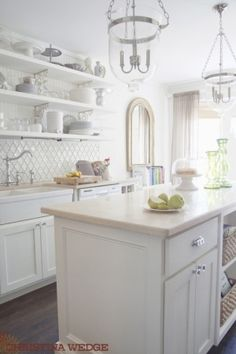 bright, white kitchen. love the backsplash. by Nicole Oliveira