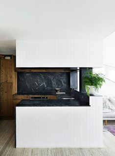 An ebony stain was applied to solid American oak joinery; the kitchen benchtops are green marble. Marble Benchtop, Kitchen Benchtops, Splashback, Timber Kitchen, New Kitchen, Black Kitchens, Home Kitchens, Exterior Design, Interior And Exterior