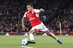 Alexis Sanchez playing football for Arsenal in the Champions League