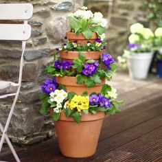 Small garden? Save space by creating an upright pot stacker. Watch this video to find out how.
