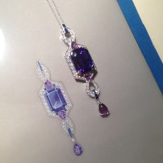 Emerald cut tanzanite and diamond pendant, finished off with carved amethyst leaves. A bespoke piece pictured next to its working drawing.