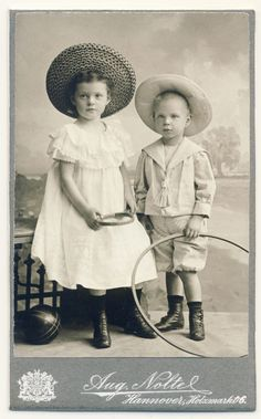 +~+~ Antique Photograph ~+~+   Siblings with a few toys including a hoop.  Circa 1905