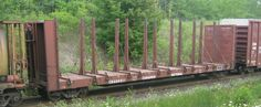 CN Rail both converted some 52' and 66' regular bulkhead flatcars to lumber cars of the same concept and usage of a centerbeam by adding rows of center posts, deck risers and ratchet tie downs.