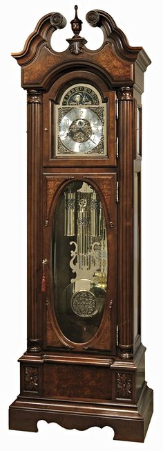 """Howard Miller Coolidge 611-180 Presidential Series Grandfather Clock in Saratoga Cherry finish with light distressing on select hardwoods and veneers. A graceful stepped, swan neck pediment features a book-matched olive ash burl overlay panel with a turned finial, rosettes, and a decorative shell ornament. Cable-driven, triple-chime Kieninger movement features an automatic nighttime chime shut-off option.   Size: H. 92-1/2"""" W. 29-3/4"""" D. 17-1/4"""""""