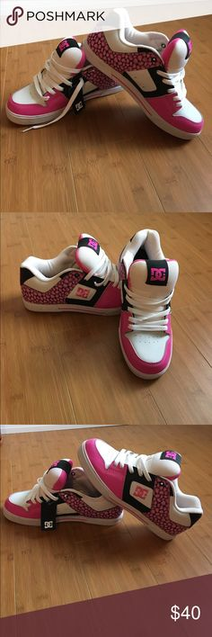 DC sneakers. Brand new with tag. Size 11 DC sneakers.  Cute pink Camo design. Size 11.   Brand new with tag. DC Shoes Sneakers