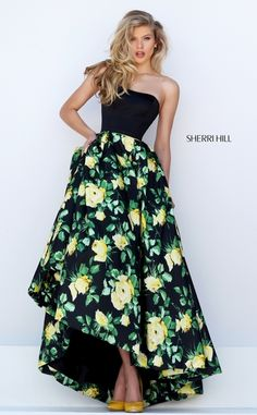 Sherri Hill 50206 is a classic floral princess dress with a fun tea length…