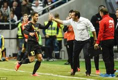 Eden Hazard high fives manager Marc Wilmots after adding a second goal for Belgium in the 2-0 win in Sweden in a warm-up friendly prior to the 2014 World Cup.