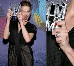 Amber Heard became engaged to Johnny Depp with this five carat oval diamond ring set in platinum